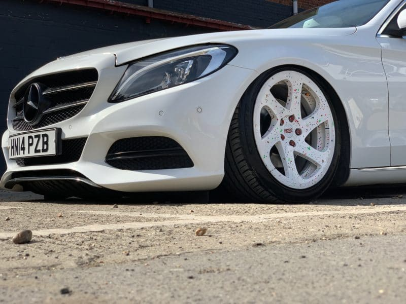 front wheel of very low mercedes in white