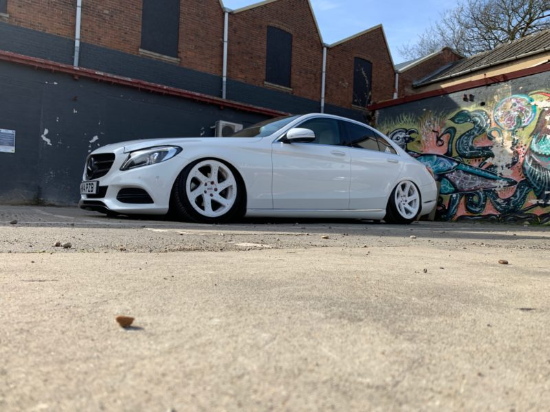 White C class mercedes benz very low on air suspension