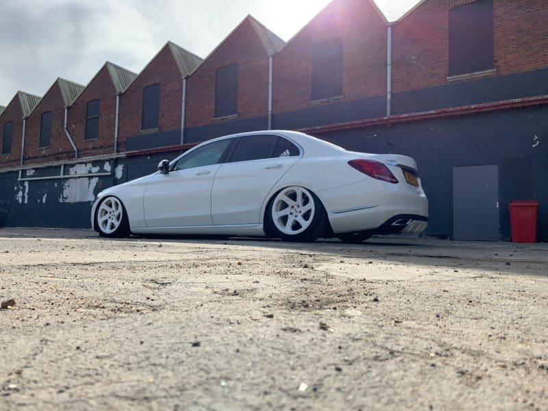 White mercedes C class looking very low on air suspension