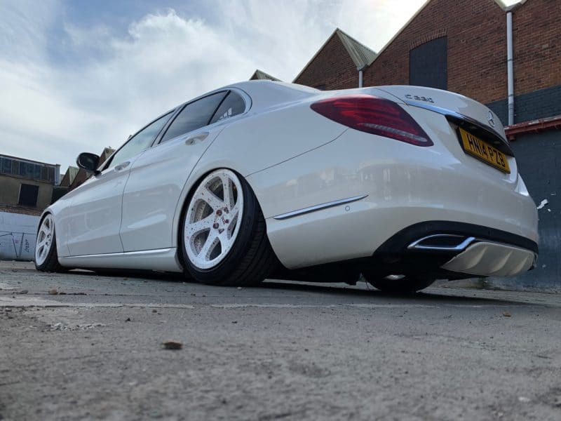 rear of low white mercedes