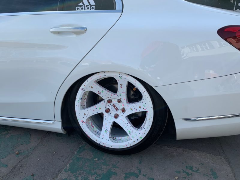 white mercedes rear wheel arch with wheel inside because its so low