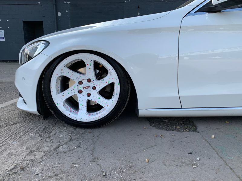 white mercedes very low front wheel