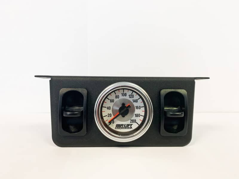 white faced gauge with black paddle controls
